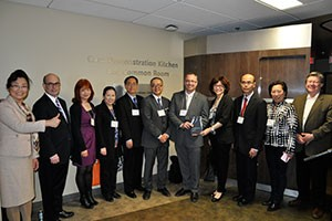 Dean Steven Murphy, CCIBD board members, and guests with Dr. Shuguang Wang at his book launch on April 23, 2014.